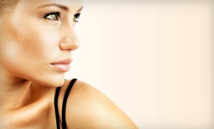 One Spray Tan, One Month of Unlimited Tanning, or Three Months of Red-Light Therapy at J2 Tanning