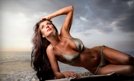 One Airbrush-Tanning Session or Two Months of Bed Tanning at Nola Salon & Tan