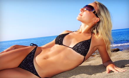 One Month of UV Tanning, One Month of Red Light Therapy, or Three Spray Tans at Envy Tan (Up to 66% Off)