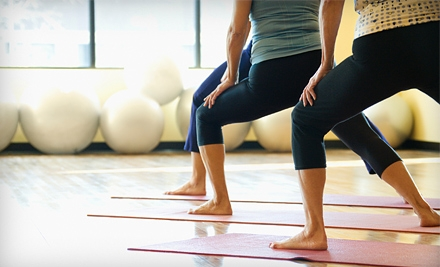 6 or 12 Drop-In Classes at Lighten Up Yoga (Up to 53% Off)