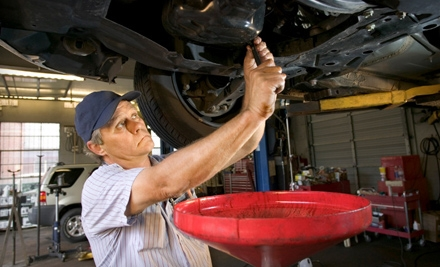 One or Three Oil-Change Packages with Tire Rotations and Multi-Point Inspections at Midas (Up to 58% Off)