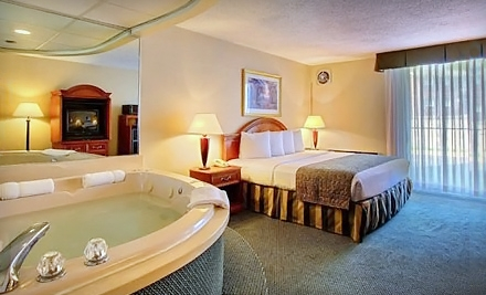 Business-Traveler Package with King Room or Date-Night Package with Jacuzzi Room at Quality Inn in Troy (Up to Half Off)