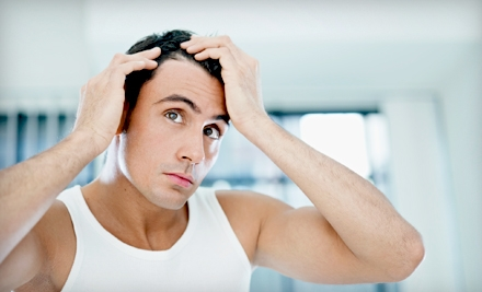 $97 for Three Months of Laser-Hair-Loss Therapy for Men or Women at Midwest Hair Loss Center ($975 Value)