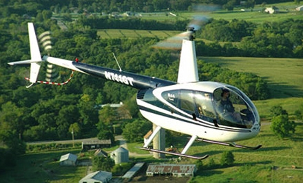 $125 for a Deluxe Holiday-Lights Helicopter Tour for Up to Three from Iowa Helicopter ($250 Value)