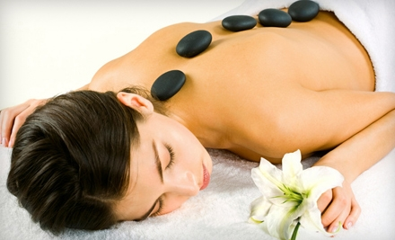 Pumpkin, TCA, or Salicylic Peel or 55-Minute Hot-Stone Massage at Caribbean Day Spa & Tanning (Up to 74% Off)
