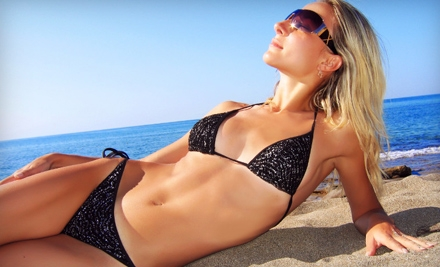 $25 for 30 Days of Unlimited UV Bed Tanning or Two VersaSpa Spray Tans at Tan Factory