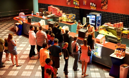 Movie Outing with Popcorn, Soda, and Candy for Two, Four, or Six at Premiere Nasa Dollar 8 in Webster (Up to 56% Off)