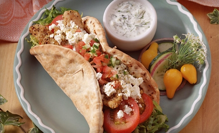 $15 for $30 Worth of Greek Cuisine at Momo's Ouzaria Taverna