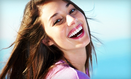 In-Office Teeth Whitening or Take-Home Whitening Kit from Newburgh Family Dental (Up to 70% Off)