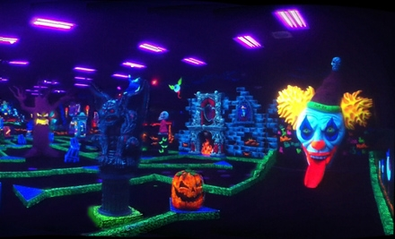 Four or Eight Black-Light Mini-Golf Passes at Monster Mini Golf in Norwood (Up to 59% Off)